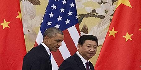 Il presidente Xi Jinping, nella foto a destra, con Barack Obama. (AFP / Mandel Ngan)