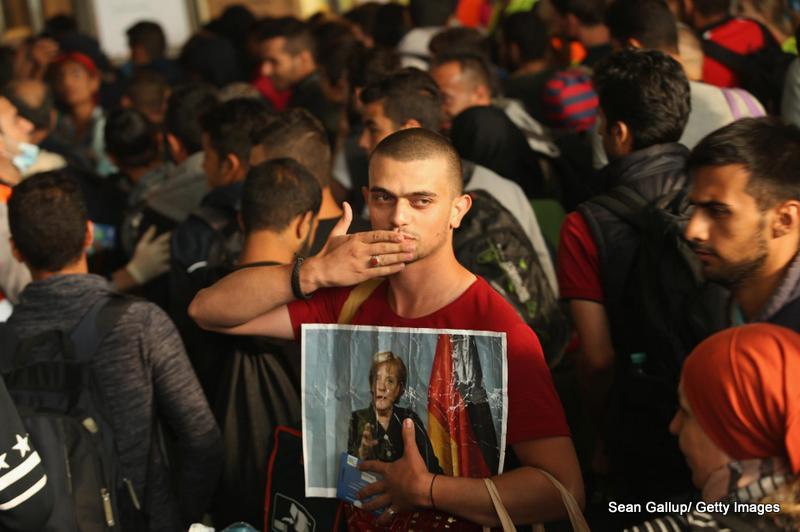 Immigrati siriani in un centro di accoglienza di Monaco di Baviera